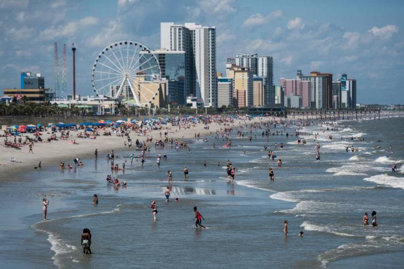 People wade in the surf in Myrtle Beach, South Carolina