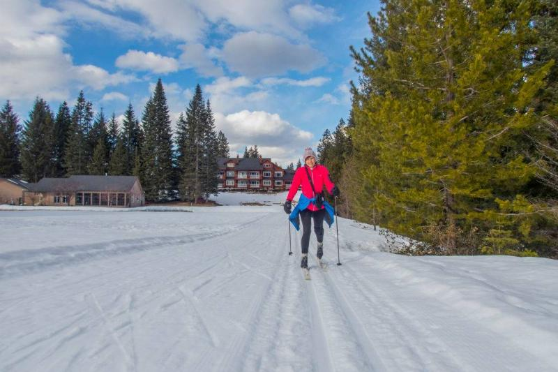 woman cross-country skiing in the spring
