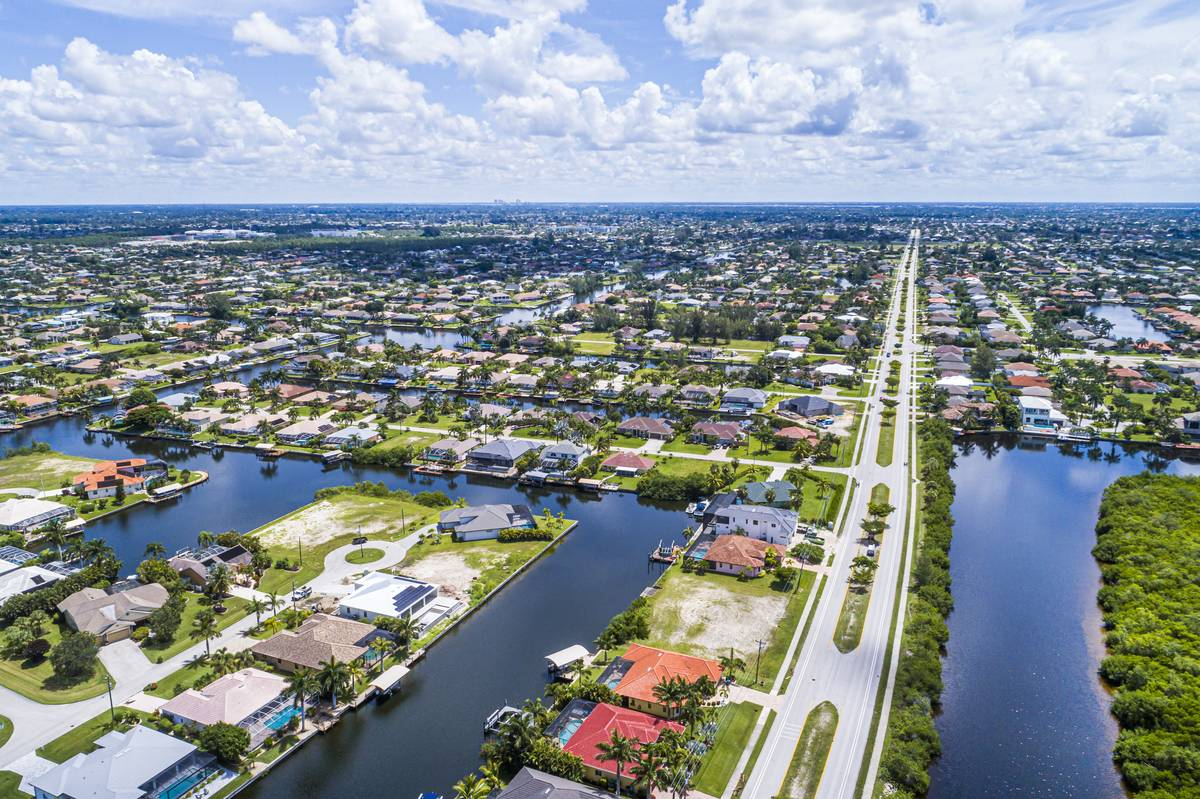 Florida, Cape Coral, South Spreader Waterway Canal, aquatic nature preserve and surrounding homes